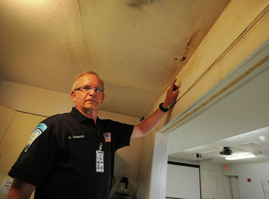 Monroe volunteer EMT Bob Zawatski shows some of the water damage caused by the old, leaking roof at Station 2 at 54 Jockey Hollow Road in Monroe, Conn. on Wednesday, May 22, 2013. Photo: Brian A. Pounds / Connecticut Post
