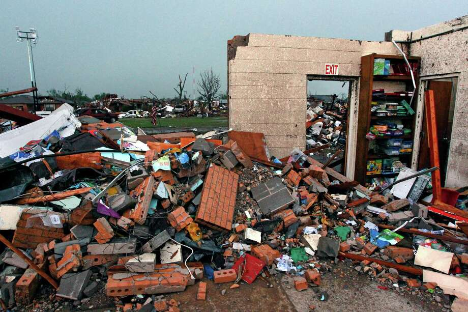 Little is left of Plaza Towers Elementary School, where seven children were killed when a tornado hit Moore, Okla. A reader suggests  all facilities in the area be built with basements. Photo: Brennan Linsley, Associated Press / AP