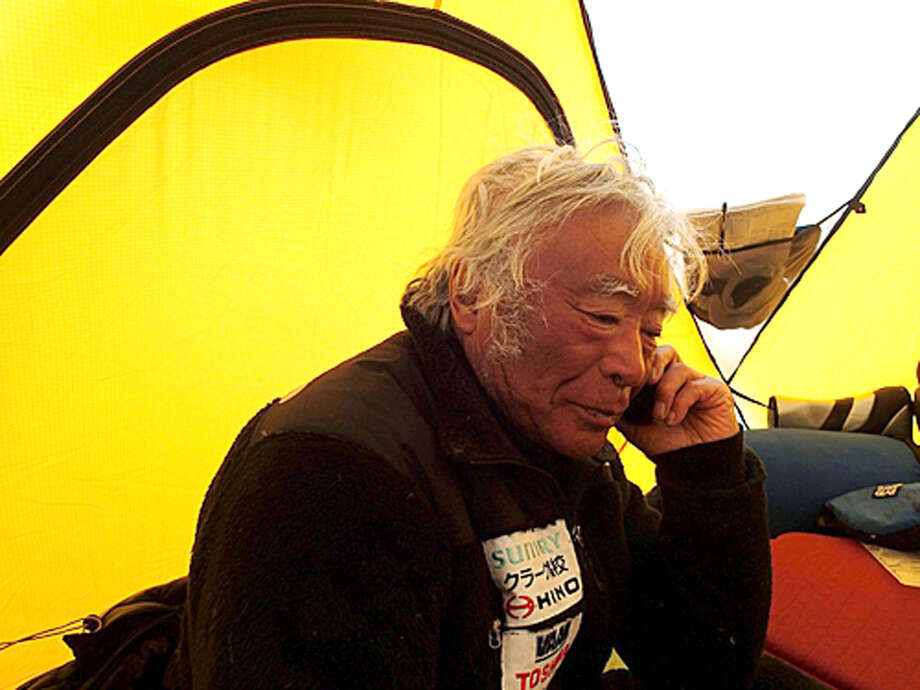 In this Tuesday, May 21, 2013, photo distributed by Miura Dolphins, 80-year-old Japanese extreme skier Yuichiro Miura rests in a camp at 8,000 meters (26,247 feet) during his attempt to scale the summit of Mount Everest. According to his management office, Miura plans to reach the 8,850-meter (29,035-foot) peak on Thursday, May 23 to be the world's oldest person to climb the world's highest peak. His rival, 81-year-old Min Bahadur Sherchan, from Nepal, who nabbed the record just before he could in 2008, was at the base camp preparing for his own attempt on the summit next week. (AP Photo/Miura Dolphins)  MANDATORY CREDIT Photo: AP / Miura Dolphins