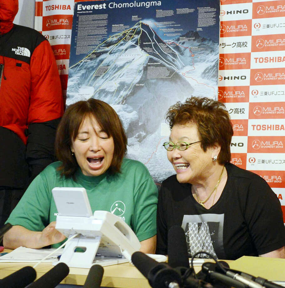 From left: Emiri Miura, daughter, and Tomoko Miura, wife of 80-year-old Japanese mountaineer Yuichiro Miura speaks with him after he conquered the summit of Mount Everest on Thursday, May 23, 2013. Miura on Thursday became the oldest person to reach the top of Mount Everest, although his record may last only a few days. An 81-year-old Nepalese man, who held the previous record, plans his own ascent next week. (AP Photo/Kyodo News) JAPAN OUT, MANDATORY CREDIT Photo: AP / Kyodo News
