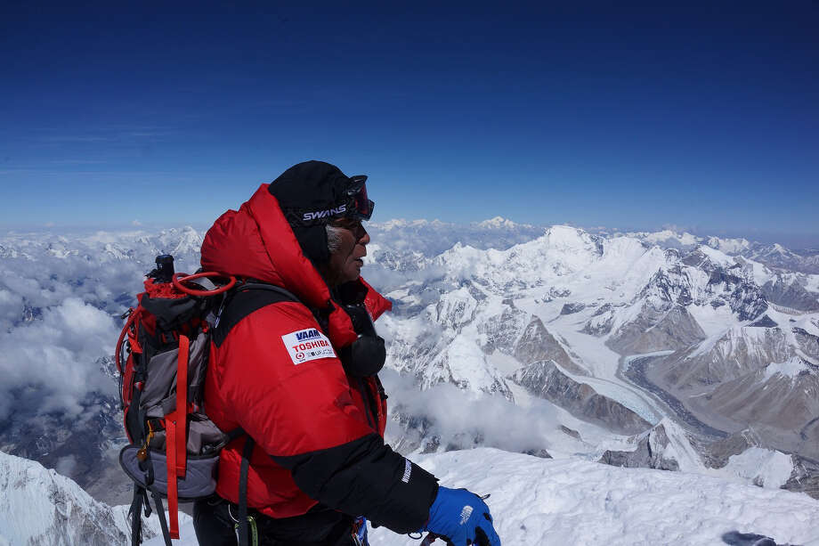 In this photo distributed by MIURA DOLPHINS CO., LTD., 80-year-old Japanese extreme skier Yuichiro Miura, right, who has had four heart operations in recent years, stands atop the summit of Mount Everest as he becomes the oldest person to climb the world's tallest mountain Thursday, May 23, 2013. Miura, who also conquered the 29,035-foot (8,850-meter) peak when he was 70 and 75, reached the summit at 9:05 a.m. local time, according to a Nepalese mountaineering official and Miura's Tokyo-based support team. (AP Photo/MIURA DOLPHINS CO., LTD.)  MANDATORY CREDIT Photo: Ap / Miura Dolphins C.. Ltd
