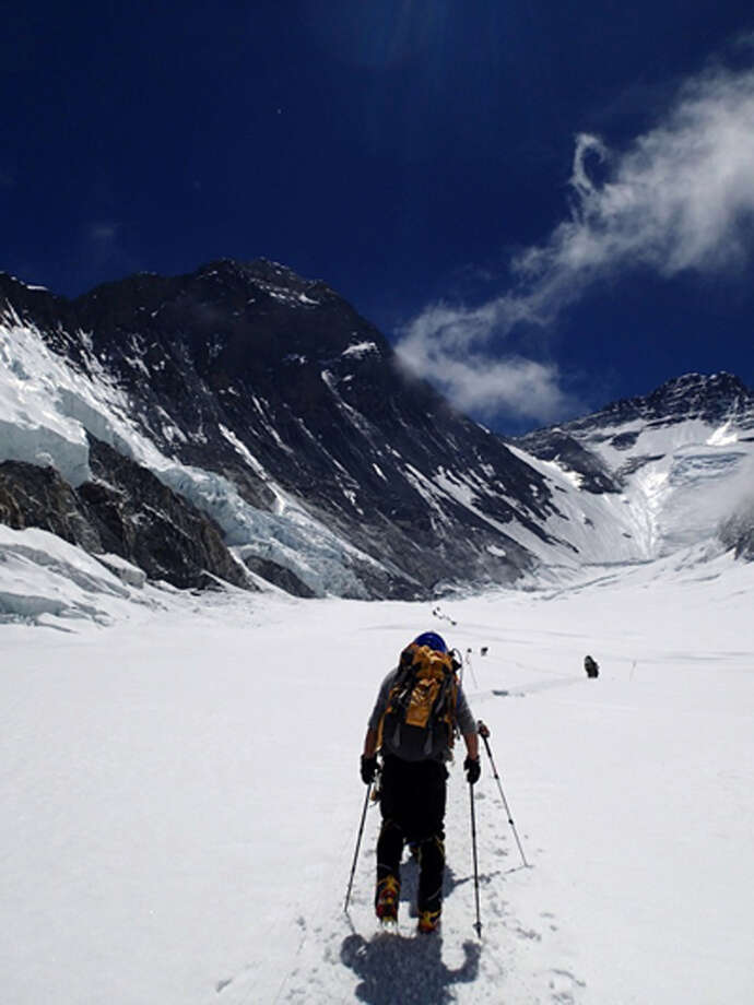 In this Friday, May 17, 2013 photo distributed by Miura Dolphins, 80-year-old Japanese adventurer Yuichiro Miura climbs through the Western Cwm glacial valley basin on his way to a camp at 6,500 meters (21,325 feet) from a camp at 6,050 meters (19,849 feet) during his attempt to scale the summit of Mount Everest. According to his management office, Miura plans to reach the 8,850-meter (29,035-foot) peak on Thursday, May 23 to be the world's oldest person to reach the world's highest peak. (AP Photo/Miura Dolphins)  MANDATORY CREDIT Photo: AP / Miura Dolphins