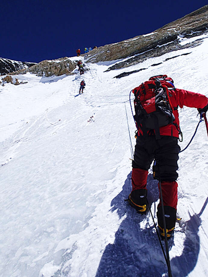 In this Tuesday, May 21, 2013 photo distributed by Miura Dolphins, 80-year-old Japanese extreme skier Yuichiro Miura goes through the South Col pass to a camp at 8,000 meters (26,247 feet) during his attempt to scale the summit of Mount Everest. According to his management office, Miura plans to reach the 8,850-meter (29,035-foot) peak on Thursday, May 23 to be the world's oldest person to climb the world's highest peak. His rival, 81-year-old Min Bahadur Sherchan, from Nepal, who nabbed the record just before he could in 2008, was at the base camp preparing for his own attempt on the summit next week. (AP Photo/Miura Dolphins)  MANDATORY CREDIT Photo: AP / Miura Dolphins