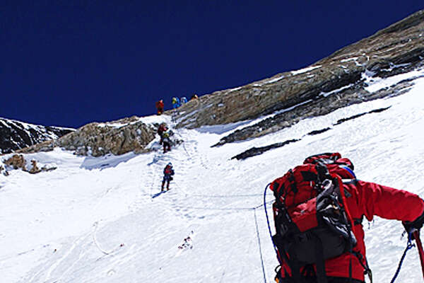 In this Tuesday, May 21, 2013 photo distributed by Miura Dolphins, 80-year-old Japanese extreme skier Yuichiro Miura goes through the South Col pass to a camp at 8,000 meters (26,247 feet) during his attempt to scale the summit of Mount Everest. According to his management office, Miura plans to reach the 8,850-meter (29,035-foot) peak on Thursday, May 23 to be the world's oldest person to climb the world's highest peak. His rival, 81-year-old Min Bahadur Sherchan, from Nepal, who nabbed the record just before he could in 2008, was at the base camp preparing for his own attempt on the summit next week. (AP Photo/Miura Dolphins)  MANDATORY CREDIT