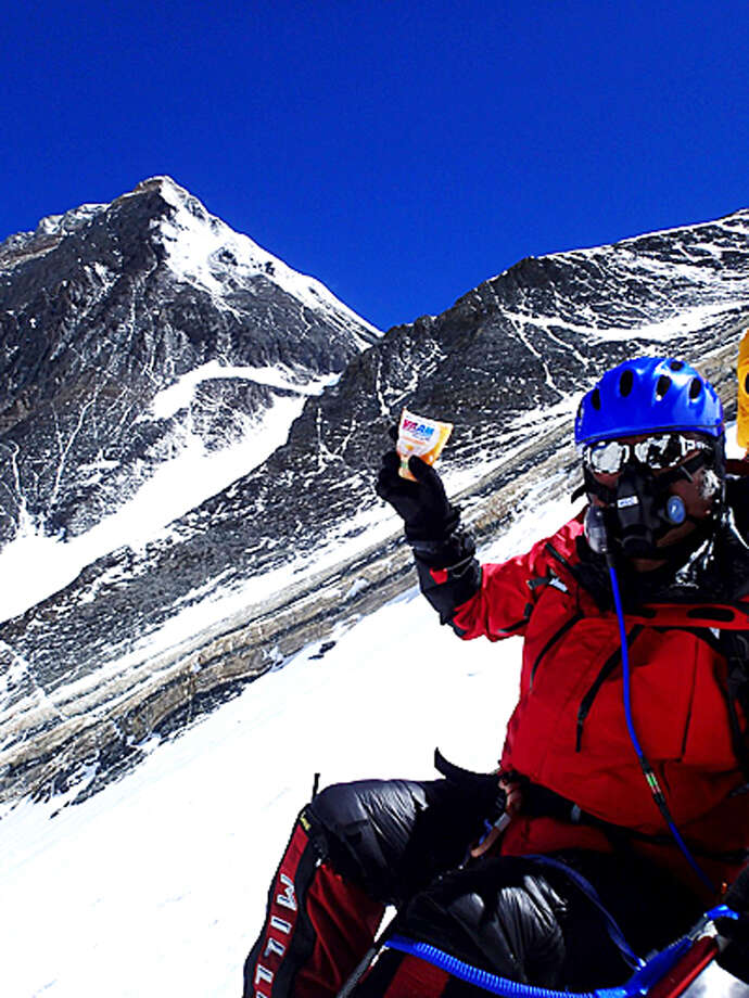In this Tuesday, May 21, 2013 photo distributed by Miura Dolphins, 80-year-old Japanese extreme skier Yuichiro Miura rests as he goes through the South Col pass to a camp at 8,000 meters (26,247 feet) during his attempt to scale the summit of Mount Everest. According to his management office, Miura plans to reach the 8,850-meter (29,035-foot) peak on Thursday, May 23 to be the world's oldest person to climb the world's highest peak. His rival, 81-year-old Min Bahadur Sherchan, from Nepal, who nabbed the record just before he could in 2008, was at the base camp preparing for his own attempt on the summit next week. (AP Photo/Miura Dolphins)  MANDATORY CREDIT Photo: AP / Miura Dolphins