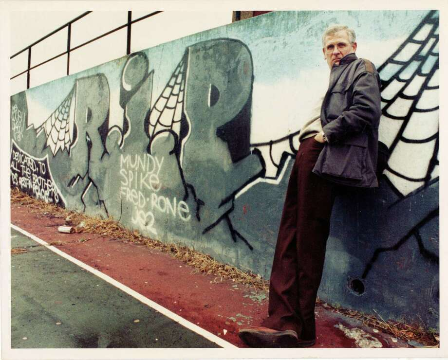 Former Connecticut Post photojournalist Wayne A. Ratzenberger, Sr. photographed in 1989 by then-intern Russ Decerbo. Wayne would take Russ with him on assignments and teach him the elements of photography. While they were on the way to an assignment one day, Wayne saw this colorful bit of graffiti and thought it would make an interesting portrait background. Photo: Contributed Photo