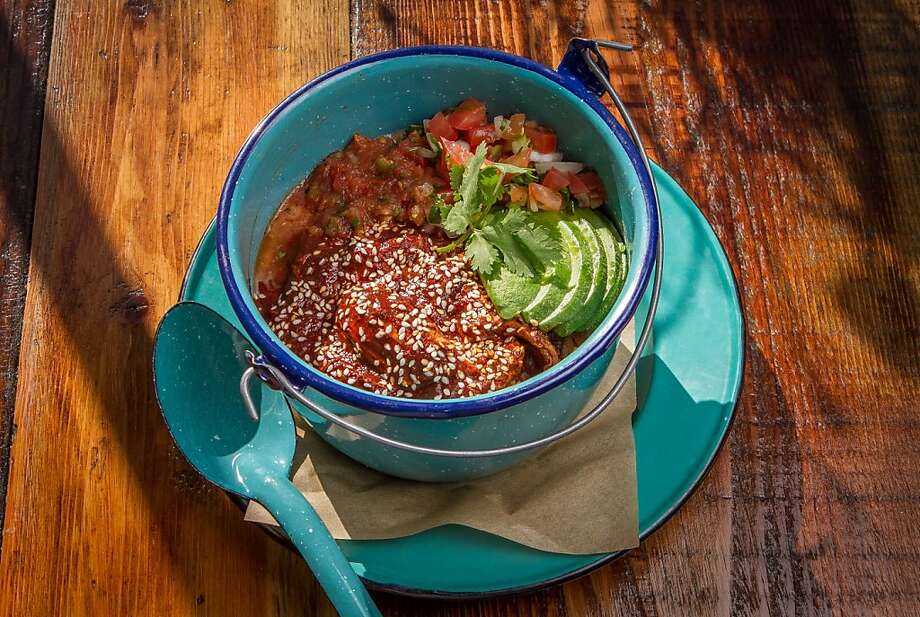 Ollita de pobre ($14) is a lidded casserole of rice, beans, avocado, salsa and a daily changing meat. Photo: John Storey, Special To The Chronicle