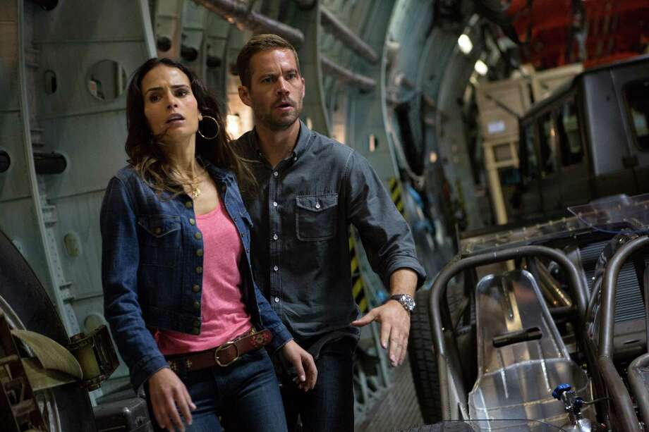 "This film publicity image released by Universal Pictures shows Jordana Brewster, left, and Paul Walker in a scene from ""Fast & Furious 6."" (AP Photo/Universal Pictures, Giles Keyte) Photo: Giles Keyte"