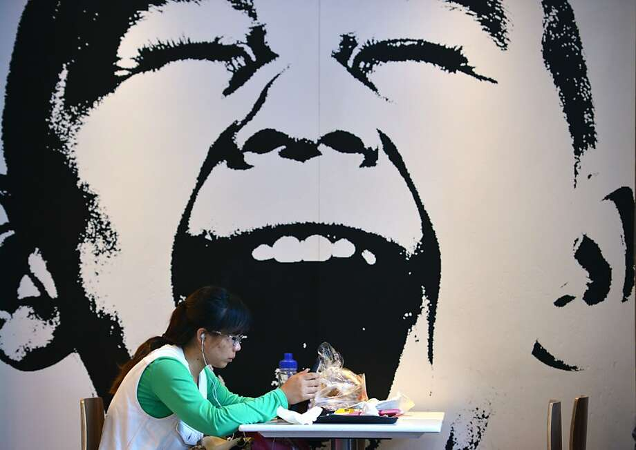 A fast-food diner enjoys a bite at a restaurant in Shanghai. Photo: Peter Parks, AFP/Getty Images