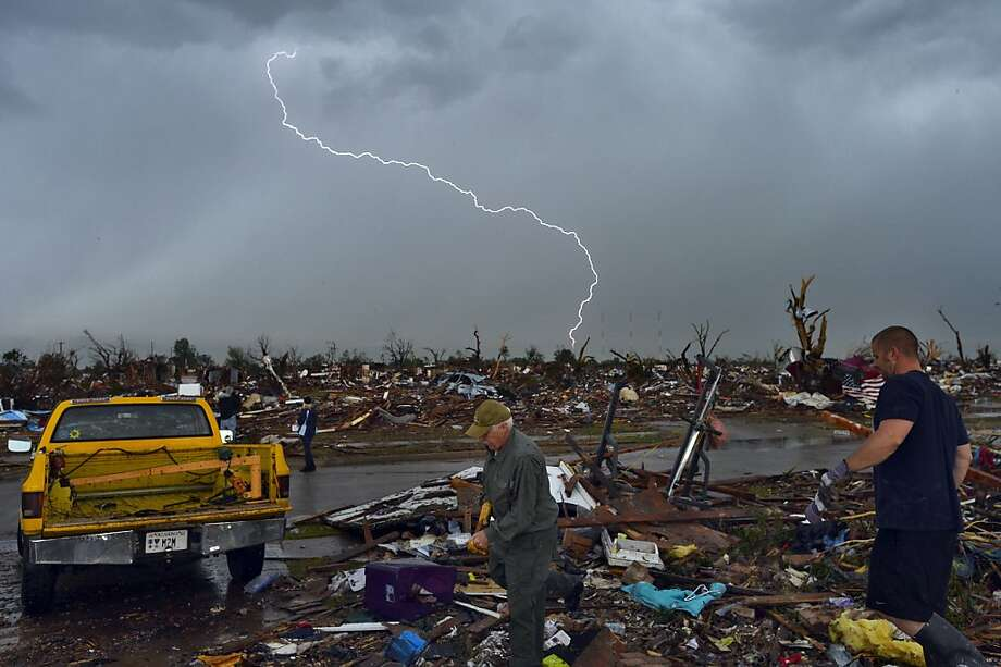 Enough already:If an EF5-strength tornado weren't bad enough, storm survivors in Moore, Okla., have to to contend with random lightning strikes as they search their destroyed homes for salvageable belongings. Photo: Jewel Samad, AFP/Getty Images