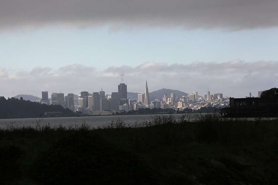 Clouds looming over the San Francisco skyline seen from the shore in Berkeley, Calif.,  on Thursday,  December 6, 2012. Photo: Liz Hafalia, The Chronicle