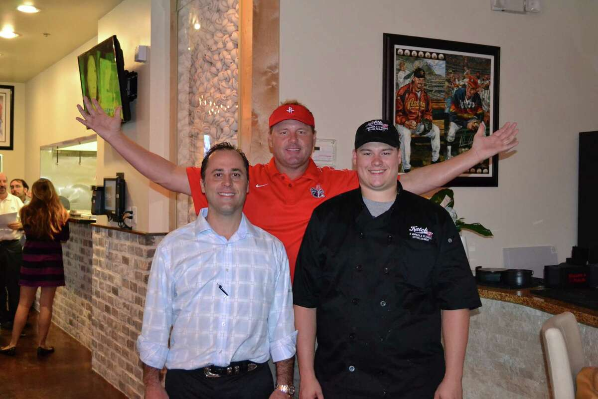 Katch 22 owners are Luke Mandola Jr., left, and chef Kory Clemens. Behind them is Roger Clemens, Kory's father. Roger is not an investor in Katch 22, but several of his jerseys are displayed there.
