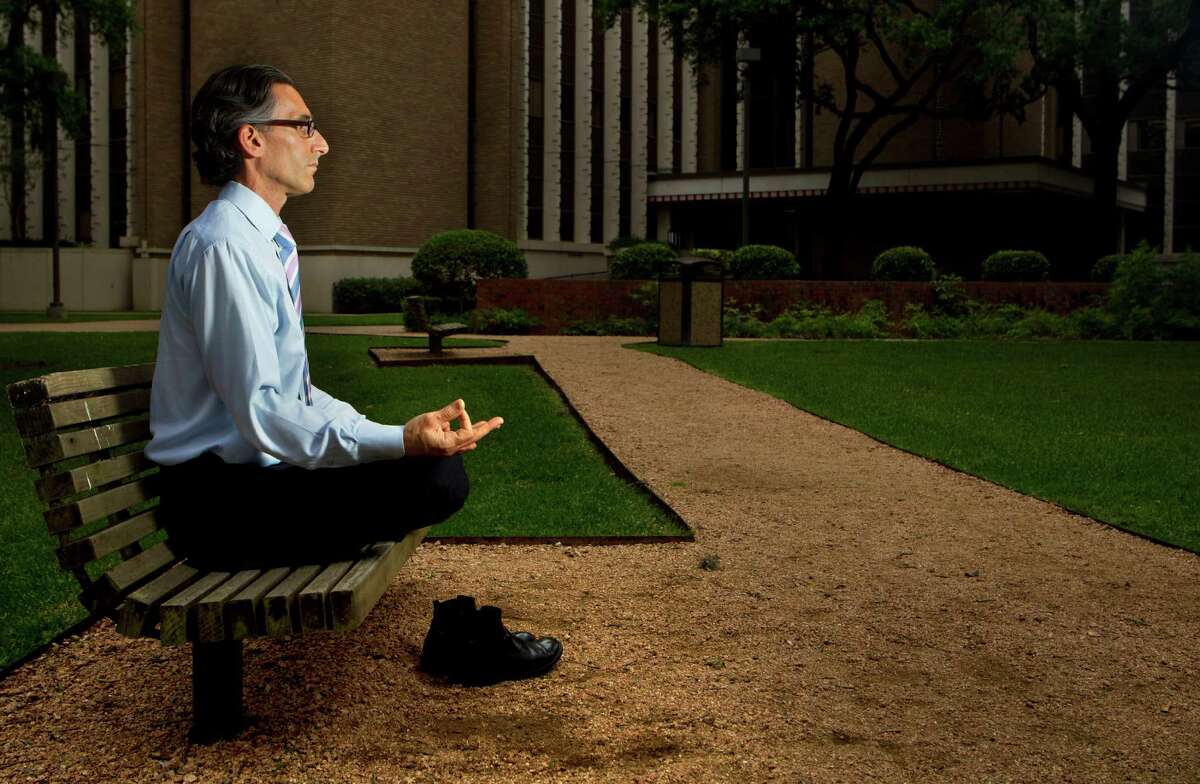 Dr. Lorenzo Cohen of M.D. Anderson meditates outside of M.D. Anderson's Cancer Prevention Building. He recently published a study about how the ancient practice of Qigong helps cancer patients cope with the disease and its side effects.