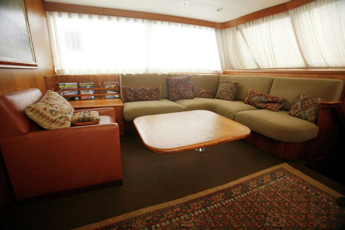 File-In this Sept. 8, 2009 file photo, the main cabin of Bernard Madoff's fishing boat, Bull, is seen. The U.S. Marshall's will hold a private auction to sell the 55-foot yacht and two smaller vessels in Fort Lauderdale, Fla., Tuesday Nov. 17, 2009.