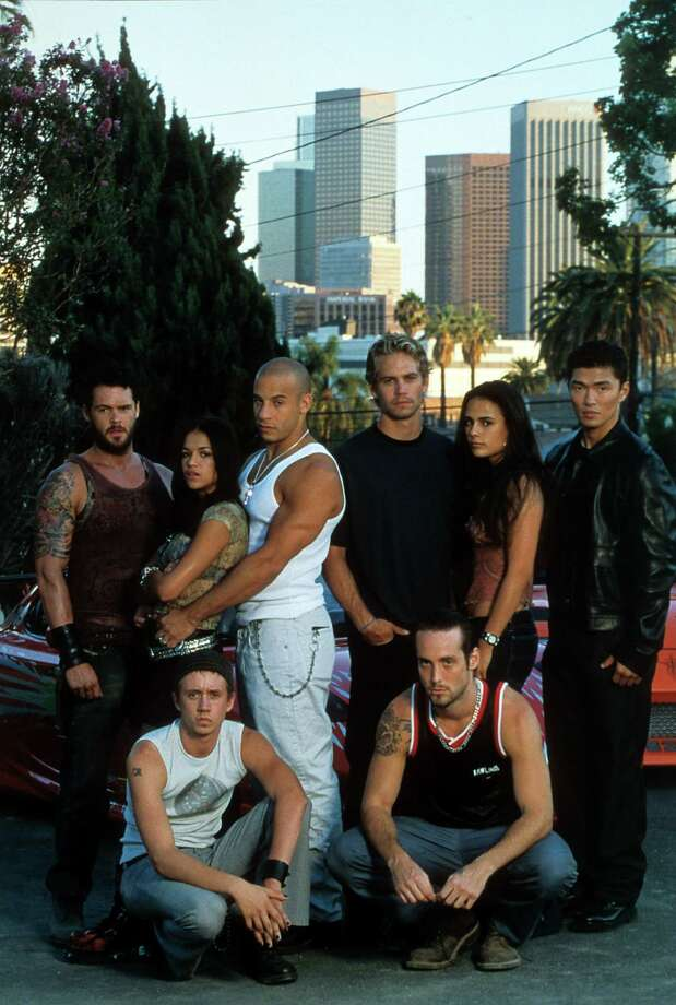 """Here's a look at the original """"Fast"""" crew on """"The Fast and The Furious."""" Matt Schulze, Chad Lindberg, Michelle Rodriguez, Vin Diesel, Paul Walker Johnny Strong, Jordana Brewster, and Rick Yune, pictured in 2001. Photo: Archive Photos, Getty Images / 2012 Getty Images"""