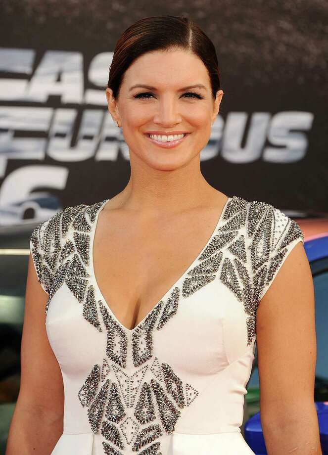 Gina Carano, pictured May 21, 2013 in Universal City, Calif. (Photo by Jason LaVeris/FilmMagic) Photo: Jason LaVeris, Getty / 2013 Jason LaVeris