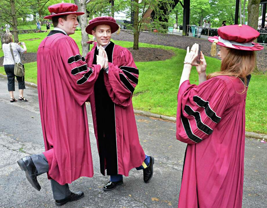 Graduatess, from left, Paul MacMahon of Poughkeepsie, Ian Mullikin of Mancos, Colo., and Deedee Blais of Herkimer mug for the camera before the start of Albany Medical College commencement at the Saratoga Performing Arts Center in Saratoga Springs, NY, Thursday May 23, 2013.  (John Carl D'Annibale / Times Union) Photo: John Carl D'Annibale / 10022119A