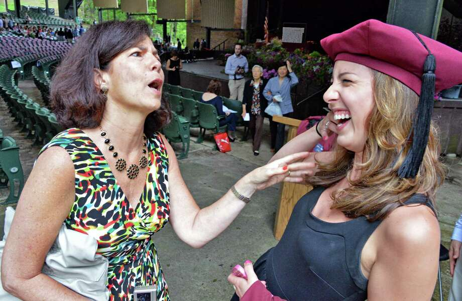 Graduate Kayla Abitabile and her mother, Renee Abitabile, of Hudson  before the start of Albany Medical College commencement at the Saratoga Performing Arts Center in Saratoga Springs, NY, Thursday May 23, 2013.  (John Carl D'Annibale / Times Union) Photo: John Carl D'Annibale / 10022119A