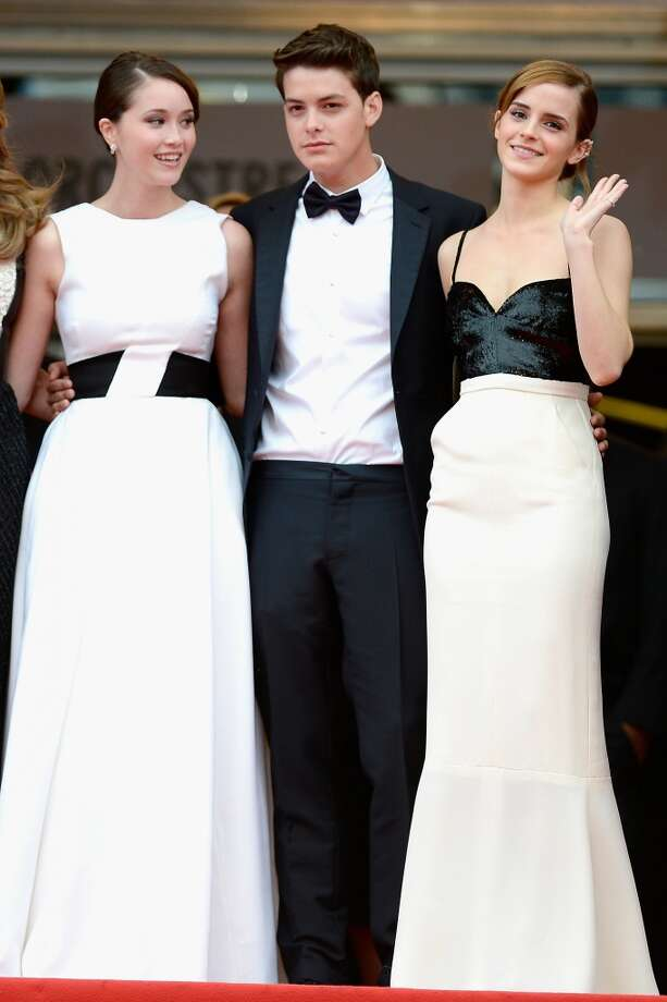 Even Israel Broussard got the secret dress code, here with  Emma Watson and Katie Chang, wearing a Christian Dior dress.