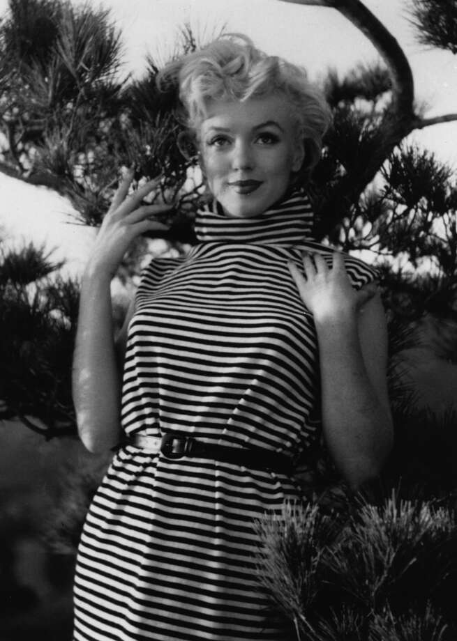 Black and white stripes worked even in the fifties, when Marilyn Monroe wore them with a turtle neck.