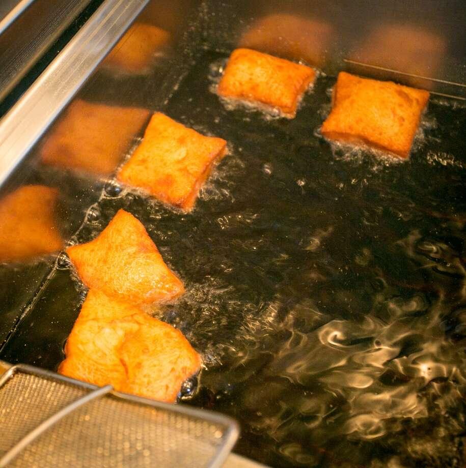 Beignets being fried.