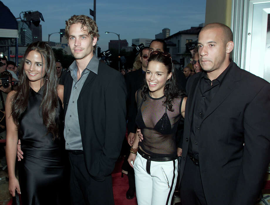 "The first ""Fast"" stars -- Jordana Brewster, Paul Walker, Michelle Rodriguez and Vin Diesel, pictured at the premiere of their film ""The Fast and the Furious"" in Los Angeles, Calif., on June 18, 2001. Photo: Kevin Winter, Getty Images / Getty Images North America"