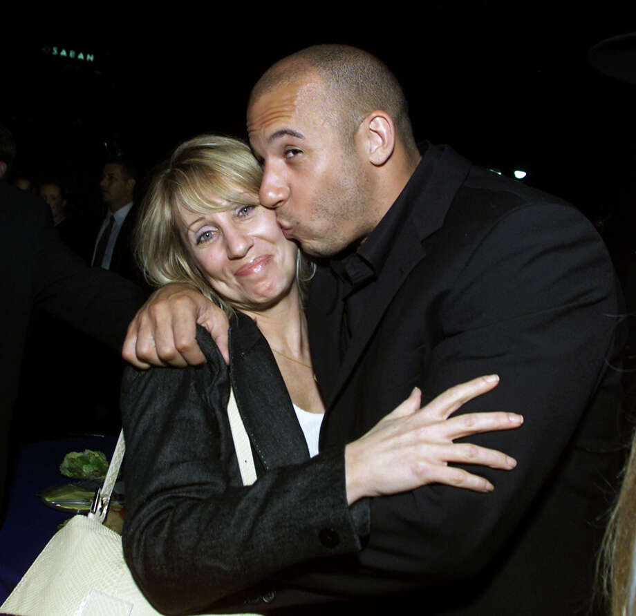 Vin Diesel, pictured on June, 18, 2001, planting one on Universal's Stacey Snider. Photo: Kevin Winter, Getty Images / Getty Images North America