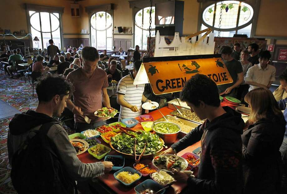 Guests line up to serve themselves during dinner at the Green Tortoise Hostel in San Francisco's North Beach. Photo: Carlos Avila Gonzalez, The Chronicle