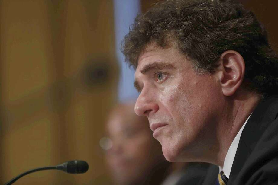 Ousted IRS chief Steve Miller testifies  on Capitol Hill. Mistakes were made, he said. Photo: Charles Dharapak, Associated Press