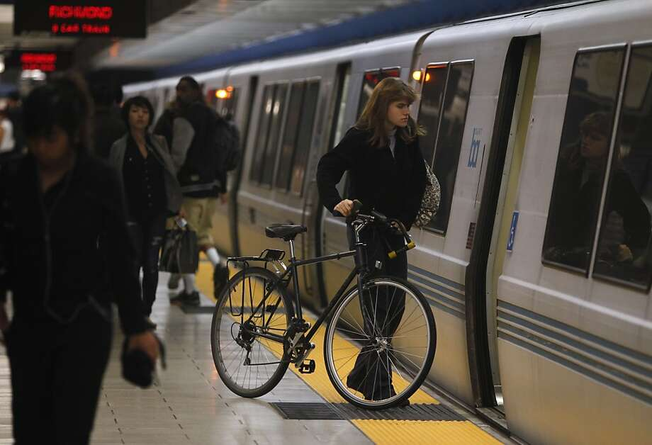 Sophie Stroik boards a train to Richmond with her bicycle at Oakland's usually crowded 19th Street BART Station during the March experiment, in which bicycles were allowed on all trains for one week. Survey results showed surprisingly strong support for ending the bicycle blackouts. Photo: Paul Chinn, The Chronicle
