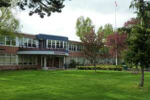 Charges: Shooter at Seattle school carried police evidence tag for gun - Photo