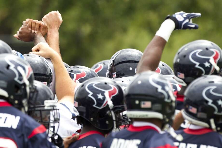 Week 1 Texans players gather together before practice during Thursday's organized team activities at the Methodist Training Center.