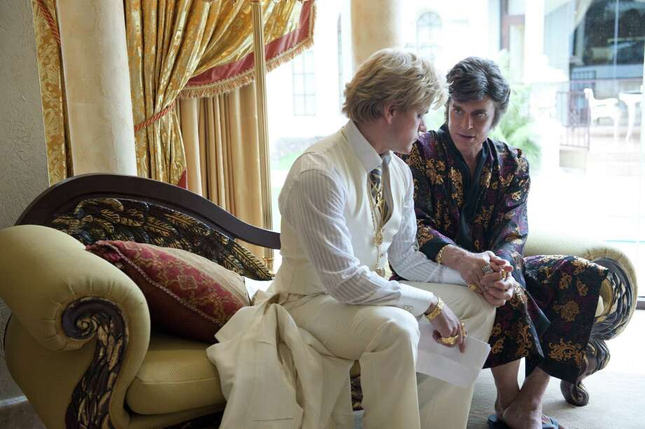 "Matt Damon (left) as Scott Thorson and Michael Douglas as Liberace in a scene from the HBO film ""Behind the Caldelabra,"" airing Sunday night. Photo: HBO"