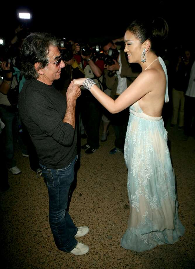 CANNES, FRANCE - MAY 20:  Designer Roberto Cavalli and actress Gong Li attend Roberto Cavalli's Yacht Party during the 60th International Cannes Film Festival on May 20, 2007 in Cannes, France.  (Photo by Chad Buchanan/Getty Images)
