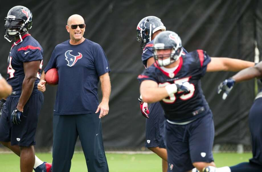 Texans defensive line coach Bill Kollar watches his players run drills.