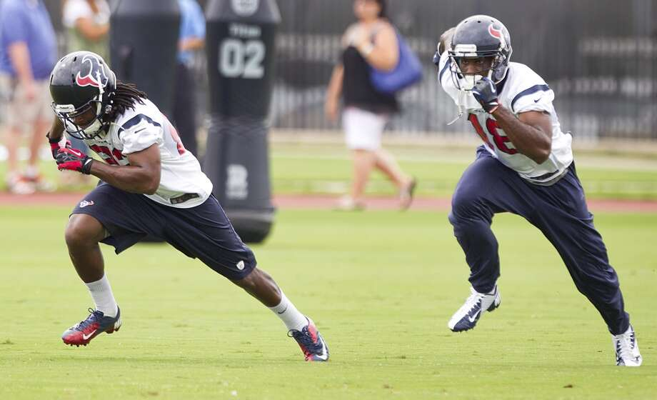 Texans wide receiver Keyshawn Martin (82) and LeStar Jean (18) run pass routes.