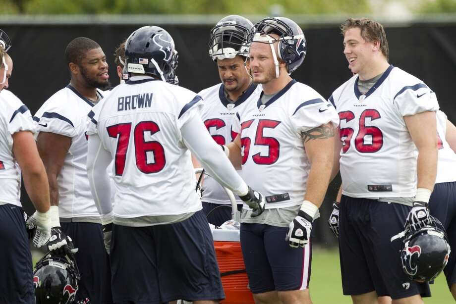Texans offensive linemen Duane Brown (76), Chris Myers (55) and Andrew Gardner (66) take a break between drills.