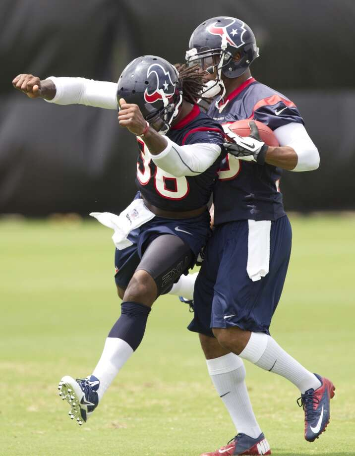 Texans defensive backs D.J. Swearinger, left, and Eddie Pleasant run a drill.