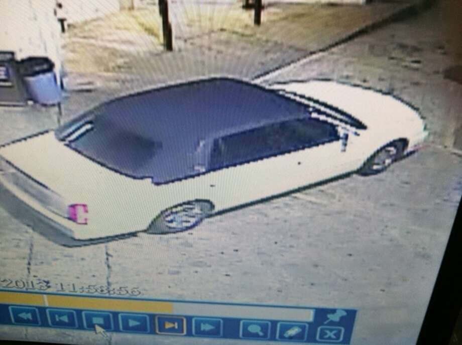 This white Cadillac with a dark roof was one of two vehicles involved in a fatal drive-by shooting Thursday in southwest Houston.