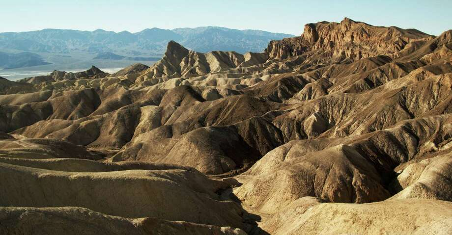 Zabriskie Point is one of the unique features of Death Valley. The eroded landscape is made of sediments from a lake that dried up five million years ago. Photo: Photos By Josh Trudell / For The Express-News