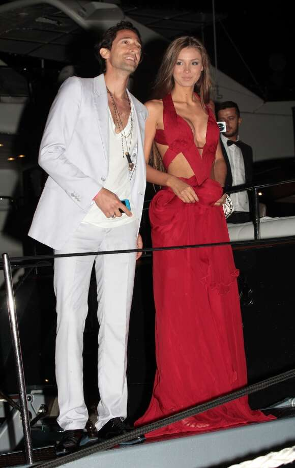 CANNES, FRANCE - MAY 22: Adrien Brody and Lara Lieto attending the Roberto Cavalli the Yacht Party during The 66th Annual Cannes Film Festival on May 22, 2013 in Cannes, France. (Photo by Mark Robert Milan/FilmMagic)