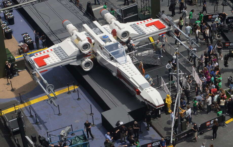 The world's largest Lego model is on display at Times Square in New York, May 23, 2013. The 11-foot-tall, 43-foot-long model, which has a 44-foot wingspan, will be on view in Times Square May 23-25, 2013. Photo: EMMANUEL DUNAND, AFP/Getty Images / 2013 AFP
