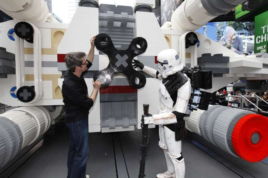 Lego Master Builder Erik Varszegi and members of the 501st inspect the thrusters of the largest Lego model ever built in New York City's Times Square on Thursday May 23, 2013.