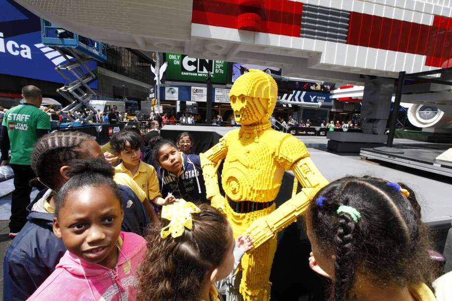 Visitors are seen after the unveiling to the world's largest Lego model in New York City's Times Square, Thursday May 23, 2013.