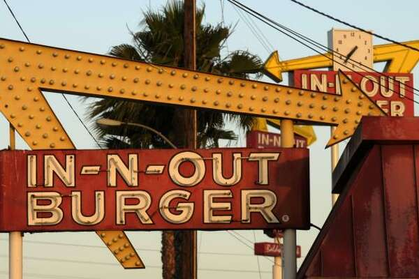 In-N-Out Besides their delicious burgers, In-N-Out is known for printing references to Bible verses on their packaging. The company's president in the '80s—a born-again Christian—thought they'd be a good evangelism tool.