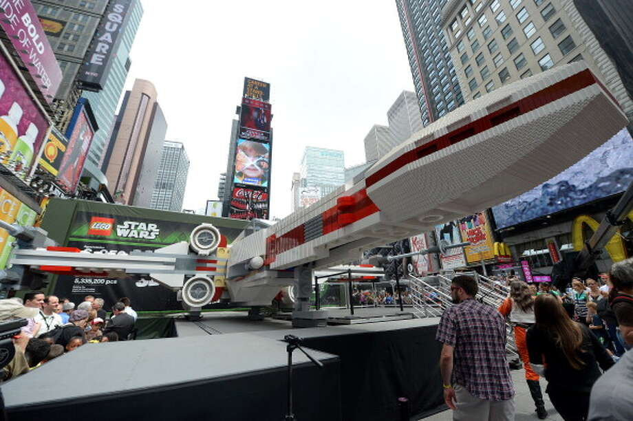 The world's largest Lego model is on display at Times Square in New York, May 23, 2013. The model is made of 5,335,200 Lego bricks and based on the X-wing starfighter that Luke Skywalker flies in the Star Wars movies. Photo: EMMANUEL DUNAND, AFP/Getty Images / 2013 AFP