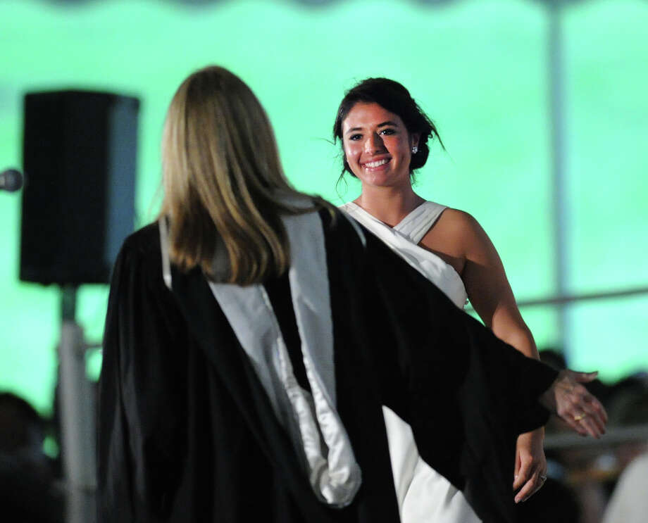 At right, Remi Berger receives her diploma during the Greenwich Academy graduation ceremony at the school in Greenwich, Thursday, May 23, 2013. Photo: Bob Luckey / Greenwich Time