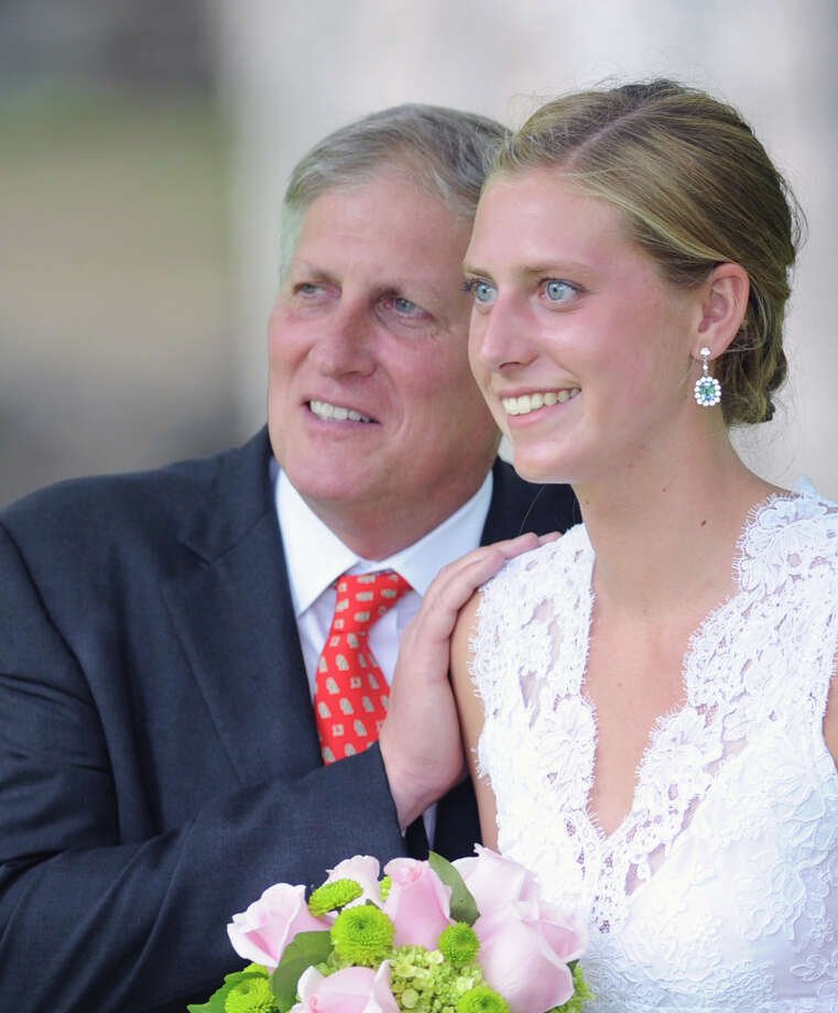 Greenwich Academy graduating senior Natalie Reynolds, 18, of Darien, with her father, Ralph, during the graduation ceremony at the school in Greenwich, Thursday, May 23, 2013. Photo: Bob Luckey / Greenwich Time