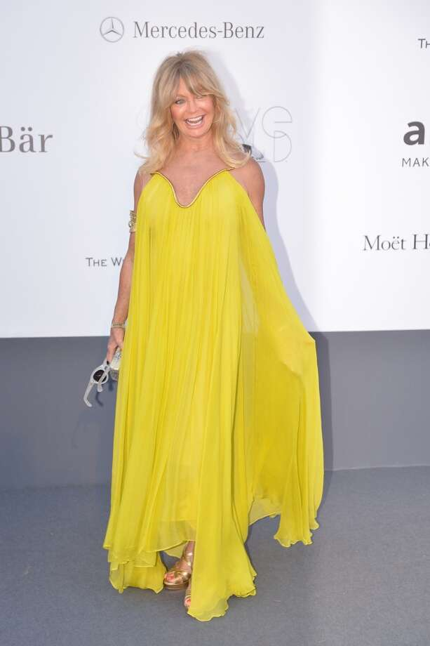 US actress Goldie Hawn poses on May 23, 2013 as she arrives for the amfAR's 20th Annual Cinema Against AIDS during the 66th Annual Cannes Film Festival at Hotel du Cap-Eden-Roc in Cap d'Antibes, southern France.   AFP PHOTO / ALBERTO PIZZOLIALBERTO PIZZOLI/AFP/Getty Images