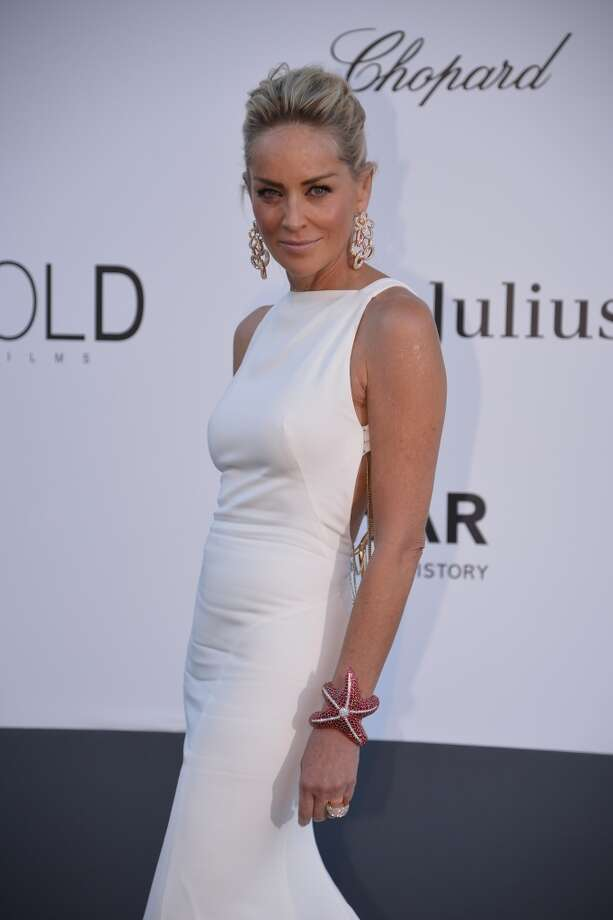 US actress Sharon Stone poses on May 23, 2013 as she arrives for the amfAR's 20th Annual Cinema Against AIDS during the 66th Annual Cannes Film Festival at Hotel du Cap-Eden-Roc in Cap d'Antibes, southern France.   AFP PHOTO / ALBERTO PIZZOLIALBERTO PIZZOLI/AFP/Getty Images